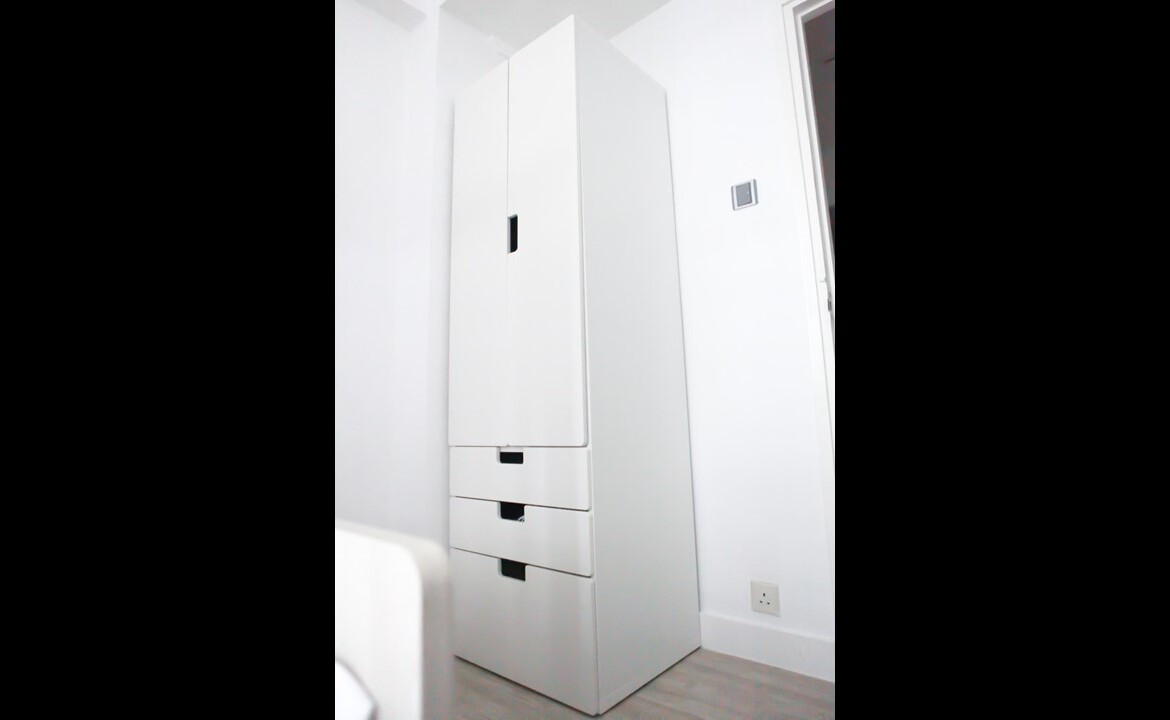 Queen size bed with white wardrobe combination in Fortress Hill 2 bedrooms apartment