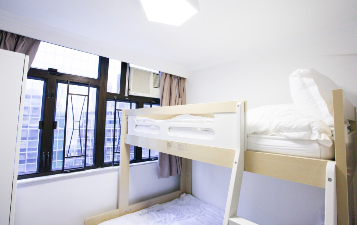 Bunk bed with white wardrobe combination in Fortress Hill 2 bedrooms apartment