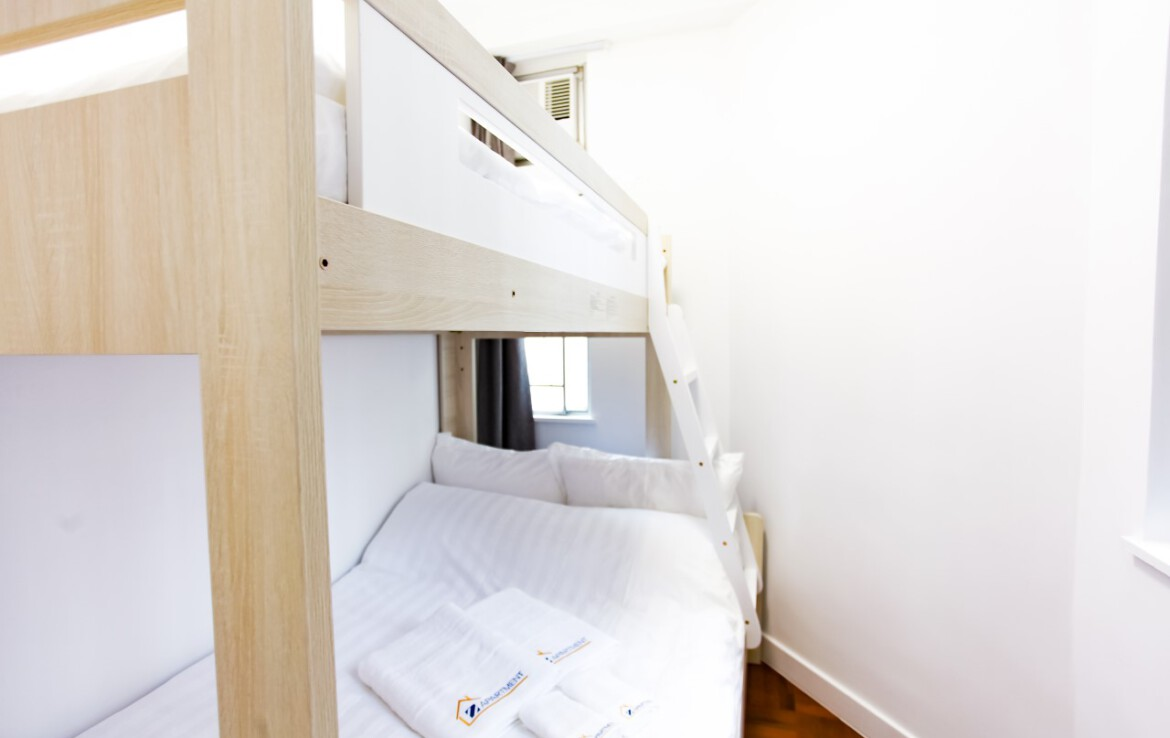 Bunk bed facing window in Fortress Hill 2 bedrooms Apartment