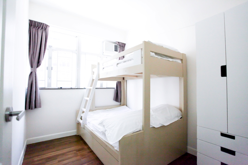 Bunk bed with white wardrobe combination facing windows in Fortress Hill 2 bedrooms apartment