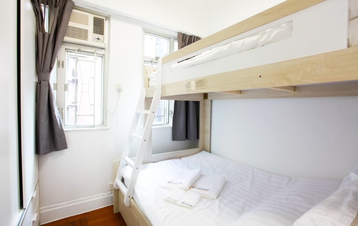 Bunk bed with white wardrobe in Tin Hau 2 BR Apartment