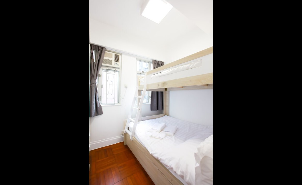 Bunk bed facing window in Tin Hau 2 BR Apartment