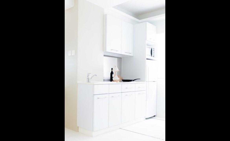 Small modern open kitchen in studio apartment Tin Hau